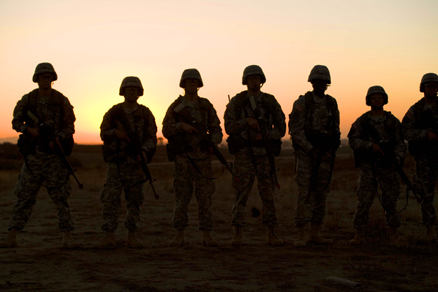 Cadets in a field at dusk